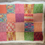 Hand knitted bright colours patchwork knee rug, afghan or throw or baby blanket
